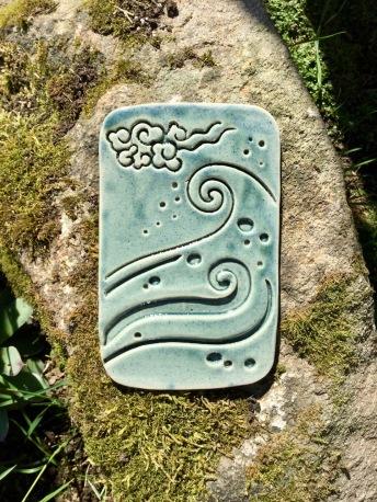 plaque décorative en céramique avec motifs marins