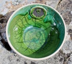 Bol raku vert avec tête de Lion